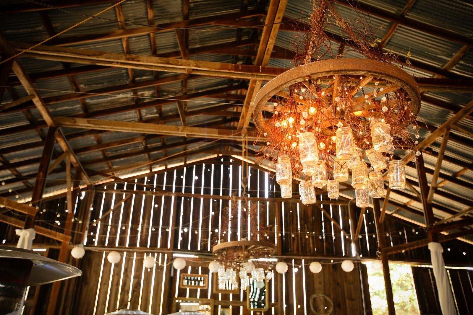 Wagon wheel chandelier with mason jars for wedding first then put wagon wheel chandelier with mason jars for wedding first then put in house arubaitofo Image collections