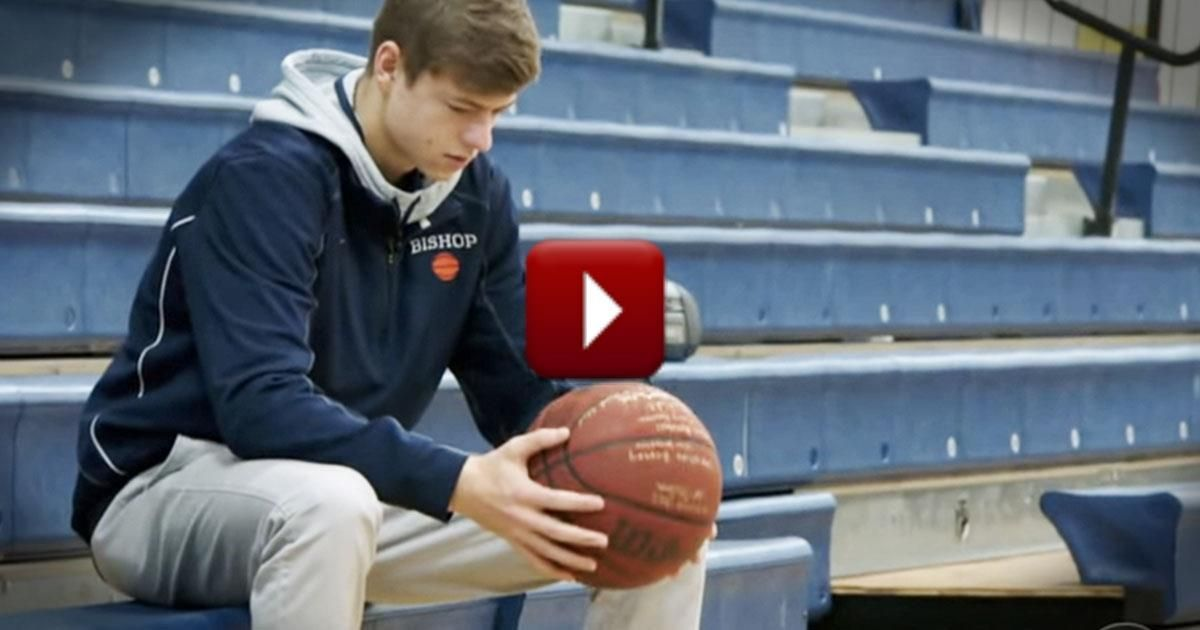 Basketball player gets assistance from above basketball