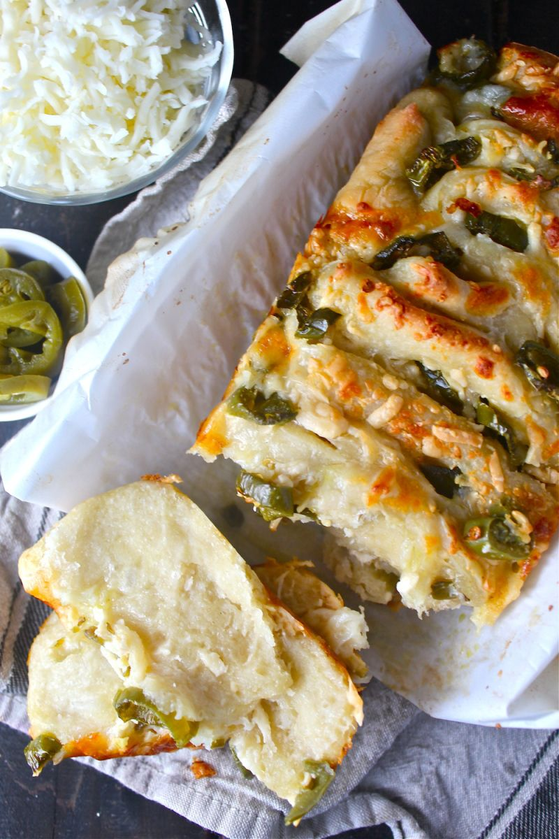 This Cheddar Jalapeño Pull Apart Bread is warm, cheesy, and slightly spicy! I love the contrast of piquant, peppery jalapeños and creamy, melty cheese – all loaded on buttery pizza dough. Con…