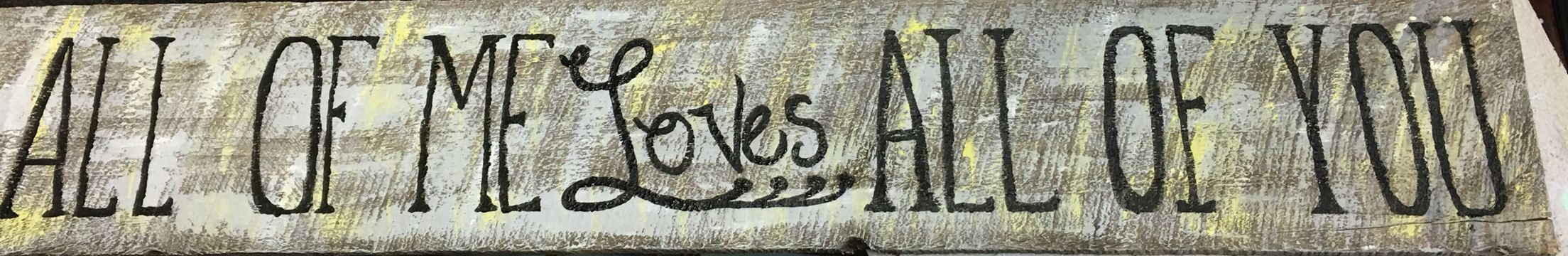 Wooden sign.  All of me loves all of you