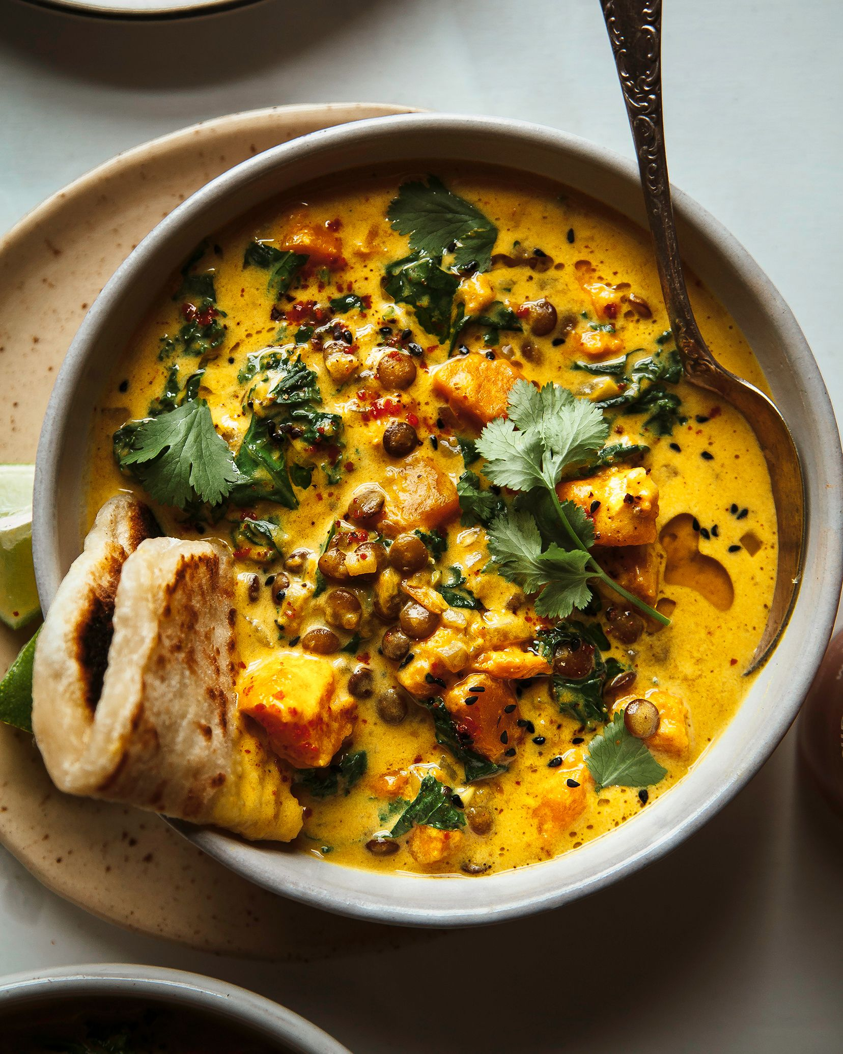 GINGER SWEET POTATO COCONUT MILK STEW WITH LENTILS & KALE