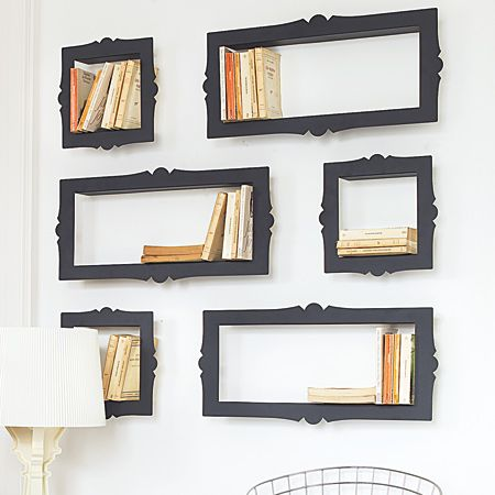 Metal bookshelves are the depth of a paperback to create a shelf-frame combo.