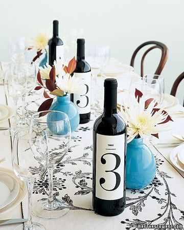 Have wine bottles do double-duty as table numbers. Cover-weight paper printed with large, graphic numerals can be adhered over existing labels with double-sided tape for a clean, contemporary look. It's a clever touch that will have guests drinking to your good fortune -- and your good taste.