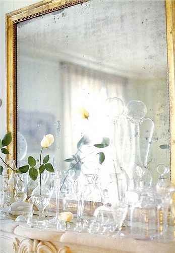 cheap and cheerful decor idea: litter your mantel with mismatched glass vases