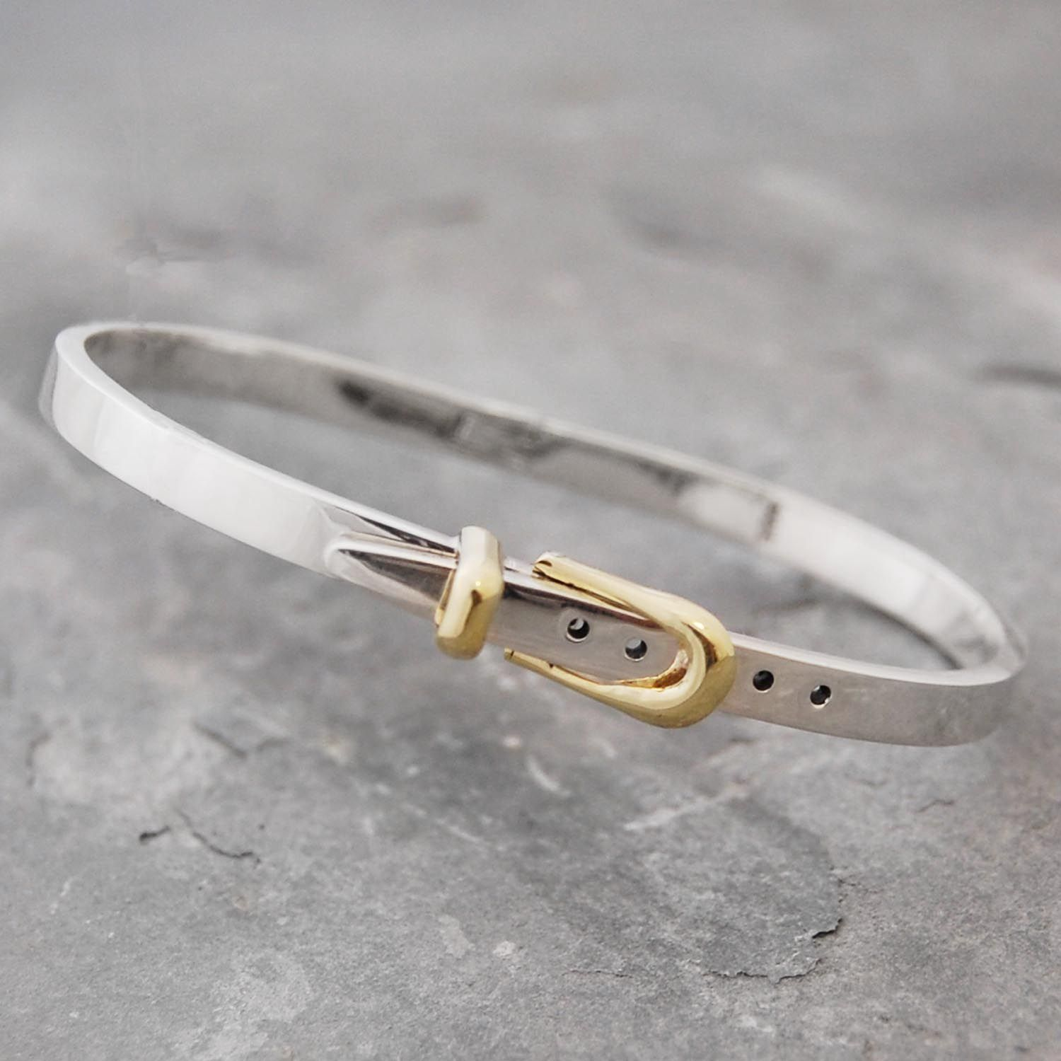 Silver belt bangle: featuring an ingenious 18k gold buckle. #Otisjaxon #Jewellery #accessories #bracelet