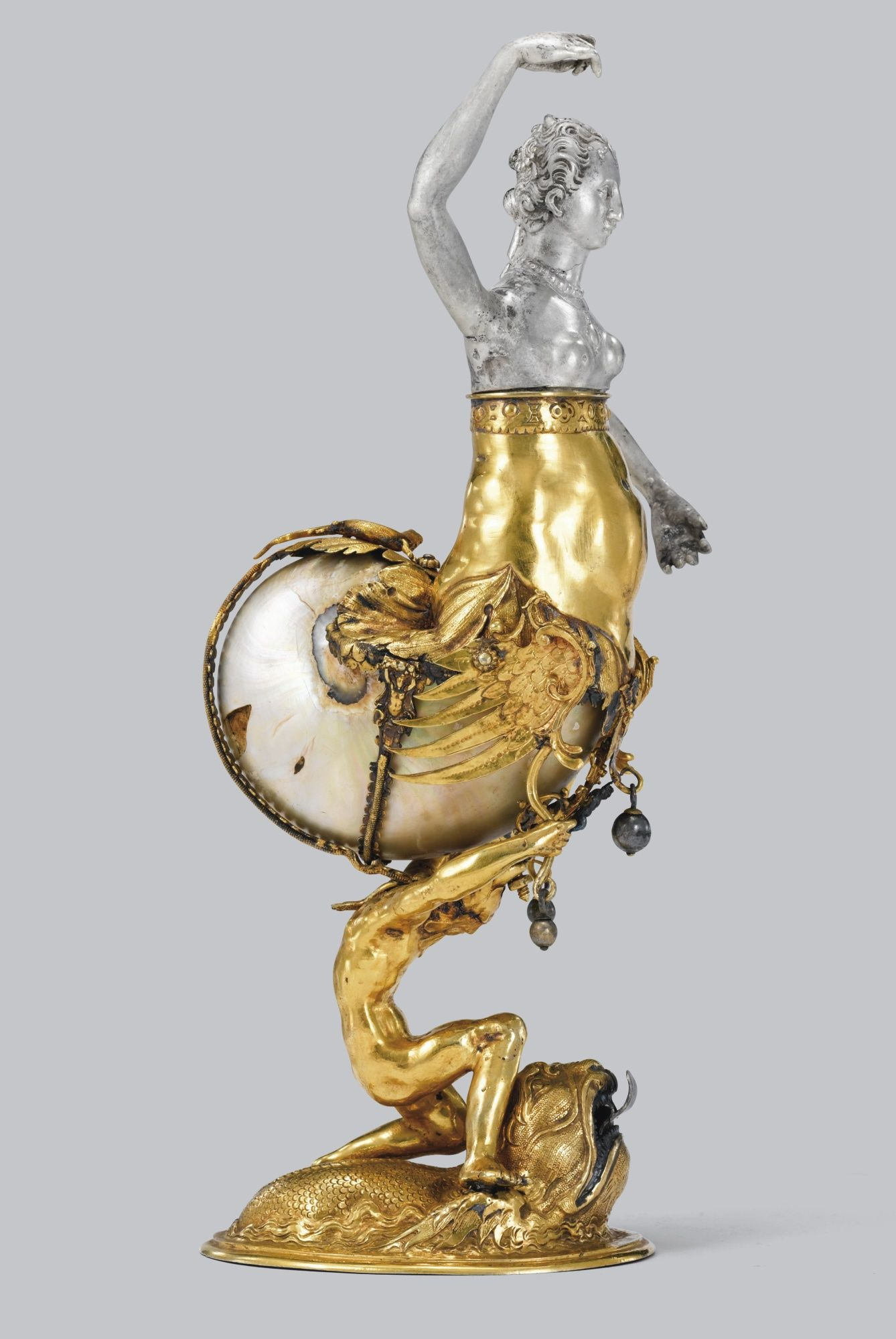 A LARGE NAUTILUS SHELL WITH PARCEL-GILT SILVER MOUNTS, PROBABLY GERMAN, CIRCA 1880