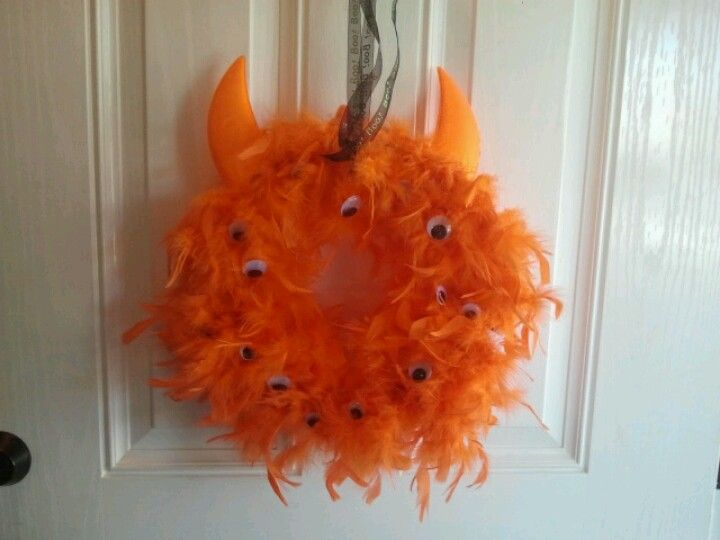 Cute and easy Halloween wreath I made with feather boa and google eyes
