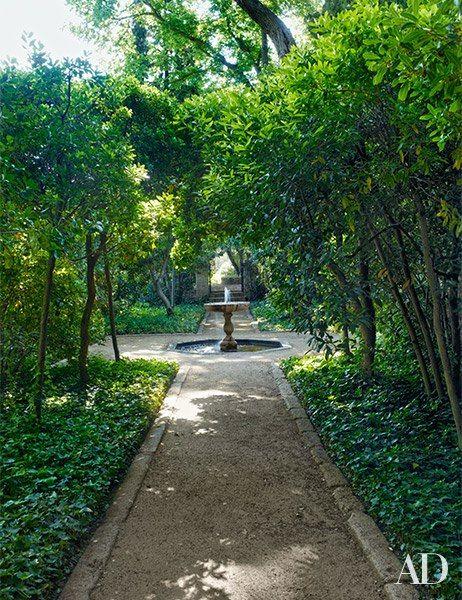 A 17th-century fountain anchors the arbutus garden.