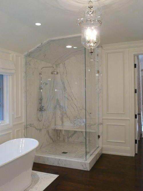 A Beautiful Bathroom Transformation Calcutta Marble Bathroom Bathroom Shower Stalls Granite Shower