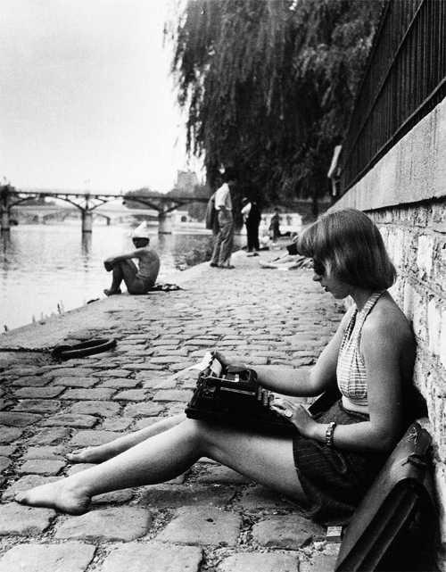 Typing. In Paris. 1947. Through the lens of Robert Doisneau.
