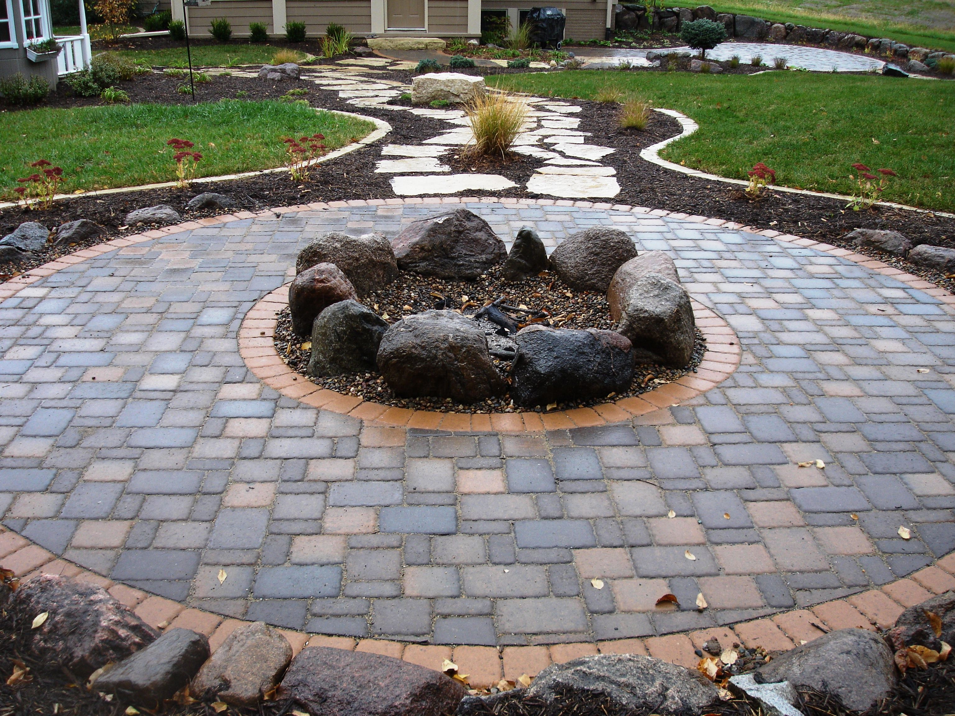 fire pits Cobble pavers with boulder firepit