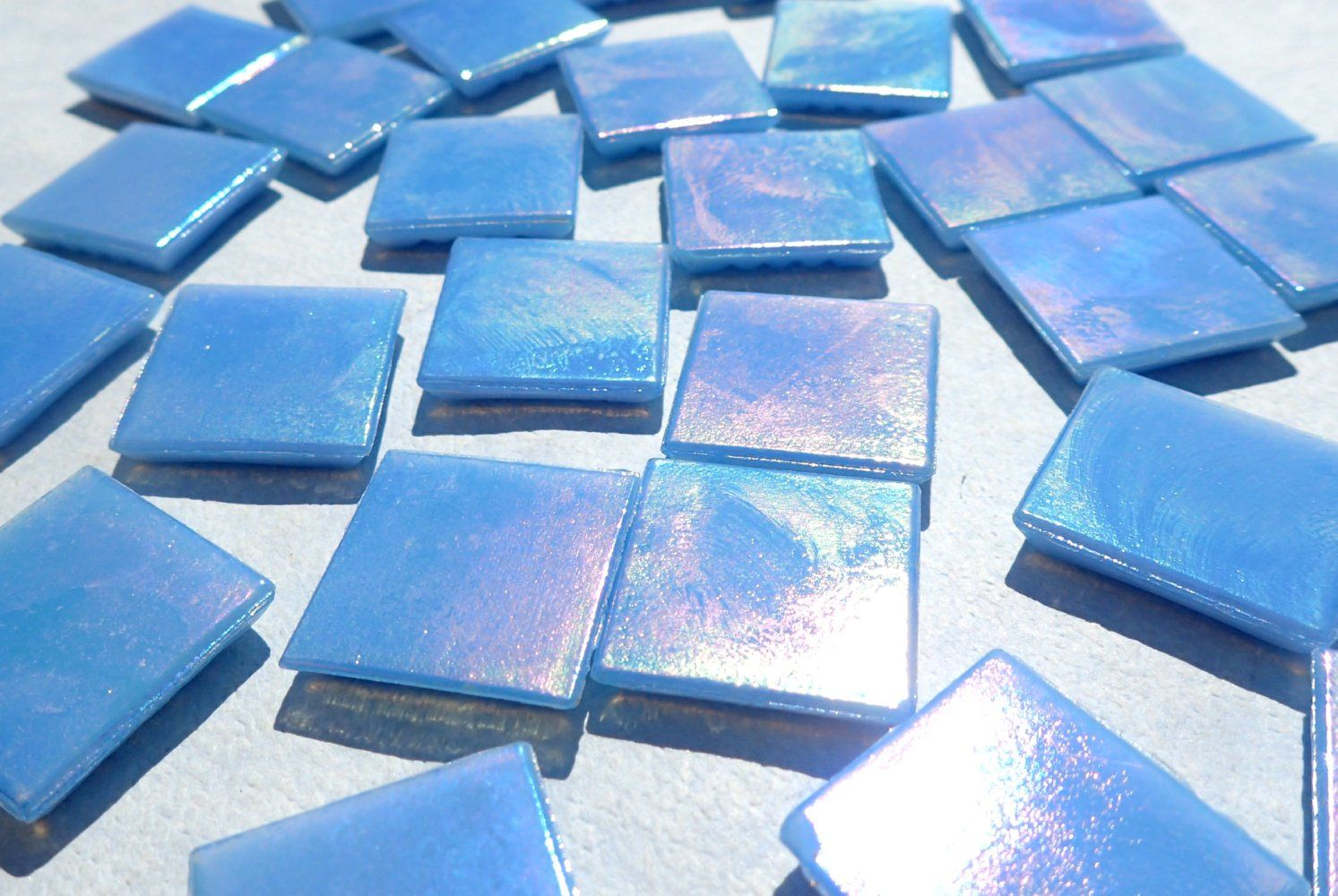 These square tiles are an opaque light blue with an iridescent ...