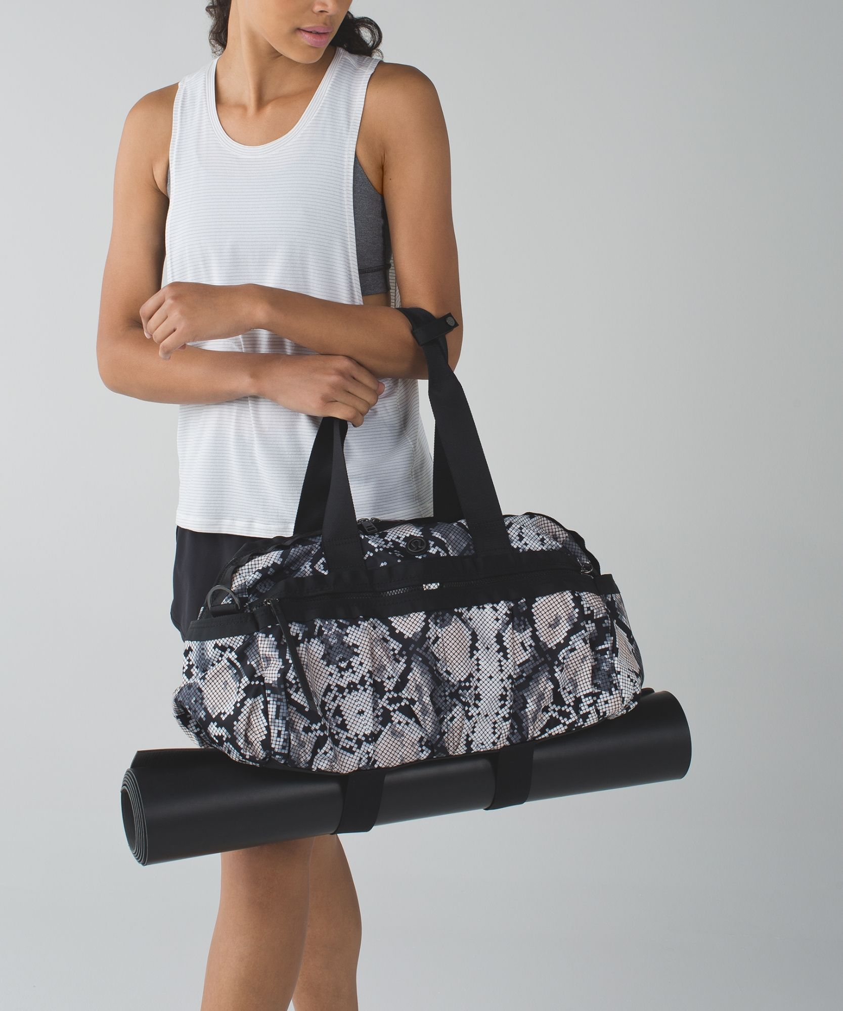 We designed this lightweight, medium-sized duffel for the busy gal on the go. The locker room-friendly  polyester fabric makes wipe-downs a breeze and exterior pockets help air out our sweaty gear. Think of it as our answer to the smelly hockey bag.