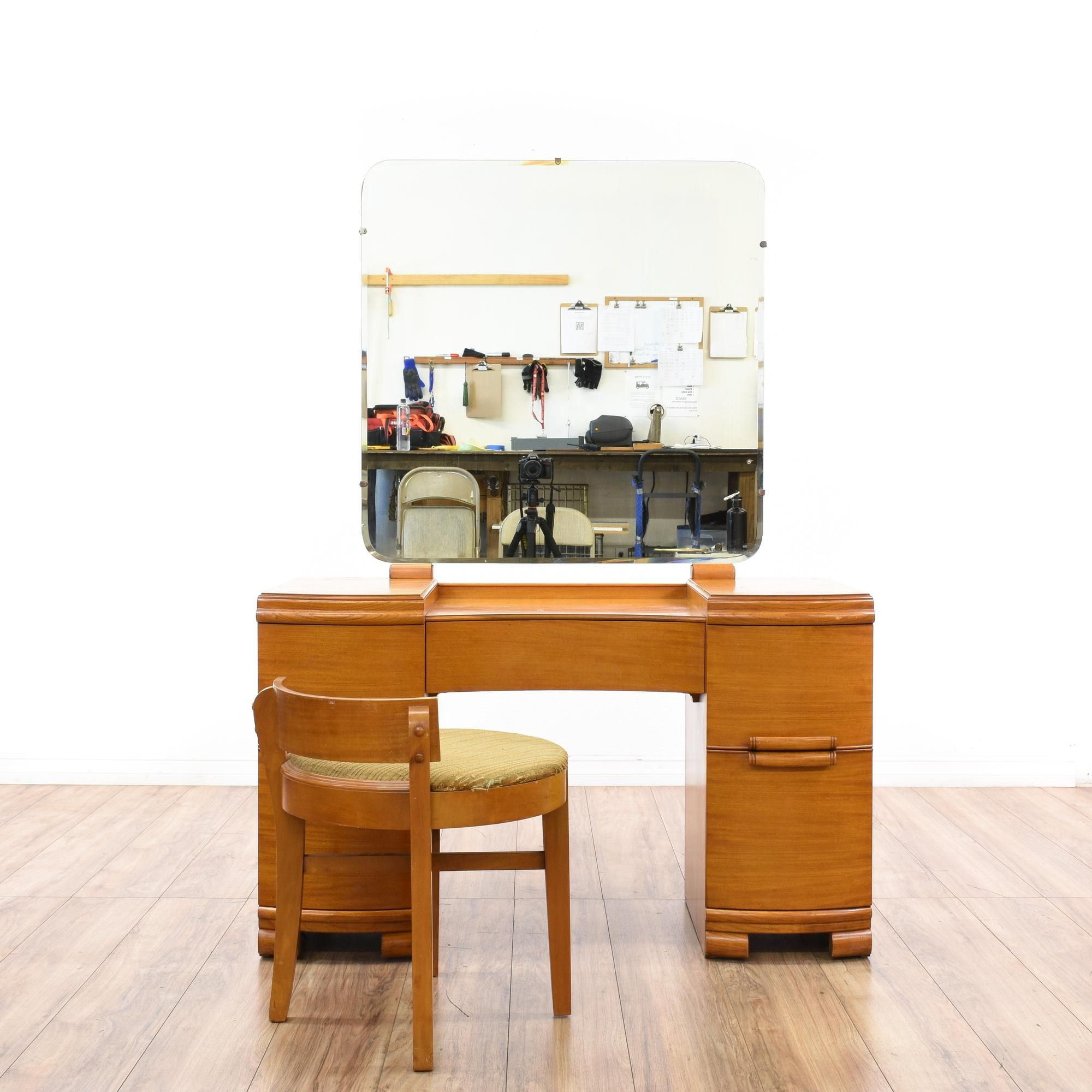 """This """"Huntley"""" vanity and bench is featured in a solid wood with a glossy light maple finish. This art deco vanity dresser has 5 curved drawers, a mirror top and a round stool bench. Stunning storage piece perfect for accenting a bedroom! #cottagechic #tables #vanity #sandiegovintage #vintagefurniture"""
