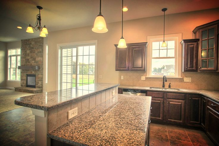 granite top kitchen island breakfast bar cheap knobs and pulls area includes an with a raised