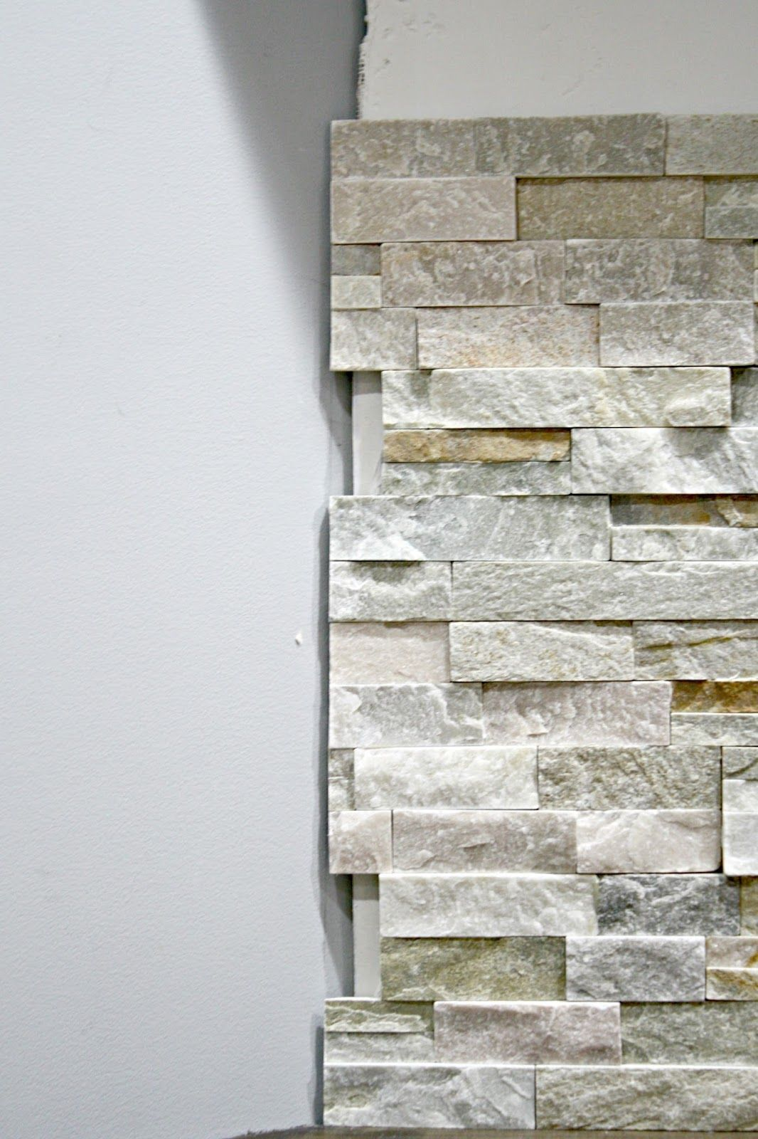 How to install stacked stone tile on a fireplace wall ...