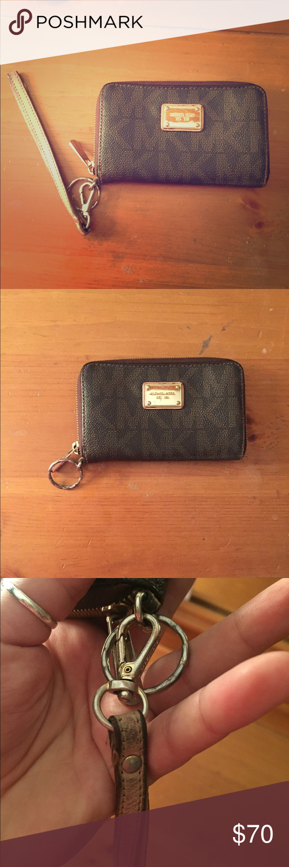 Michael Kors Wristlet Wallet Pre-Loved ❤️ Wear on the strap but as I showed in my pictures you could just take it off and use it just as a wallet if you wanted to! The rest of the wallet is in pretty good condition! Michael Kors Bags Clutches & Wristlets