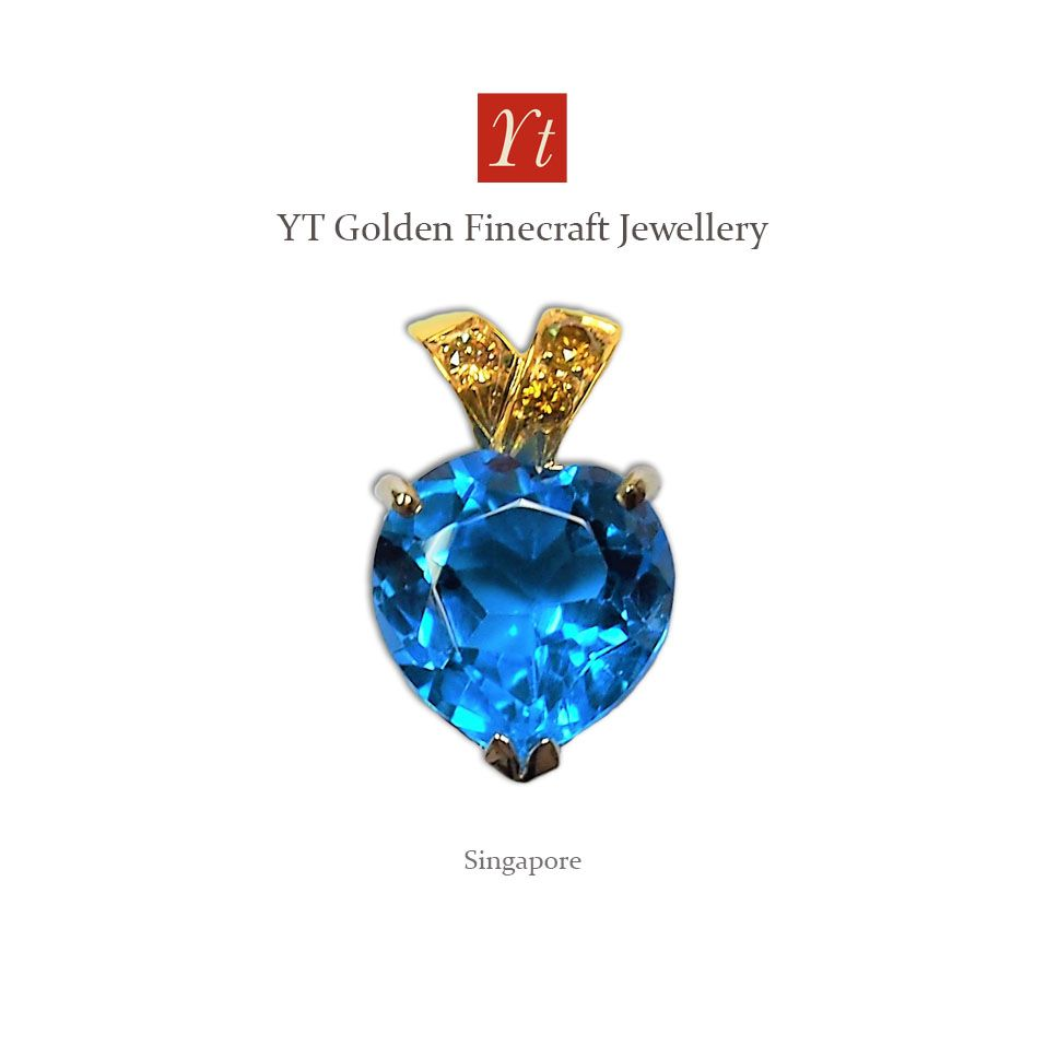 This is a pendant with heart shape topaz and yellow diamonds in