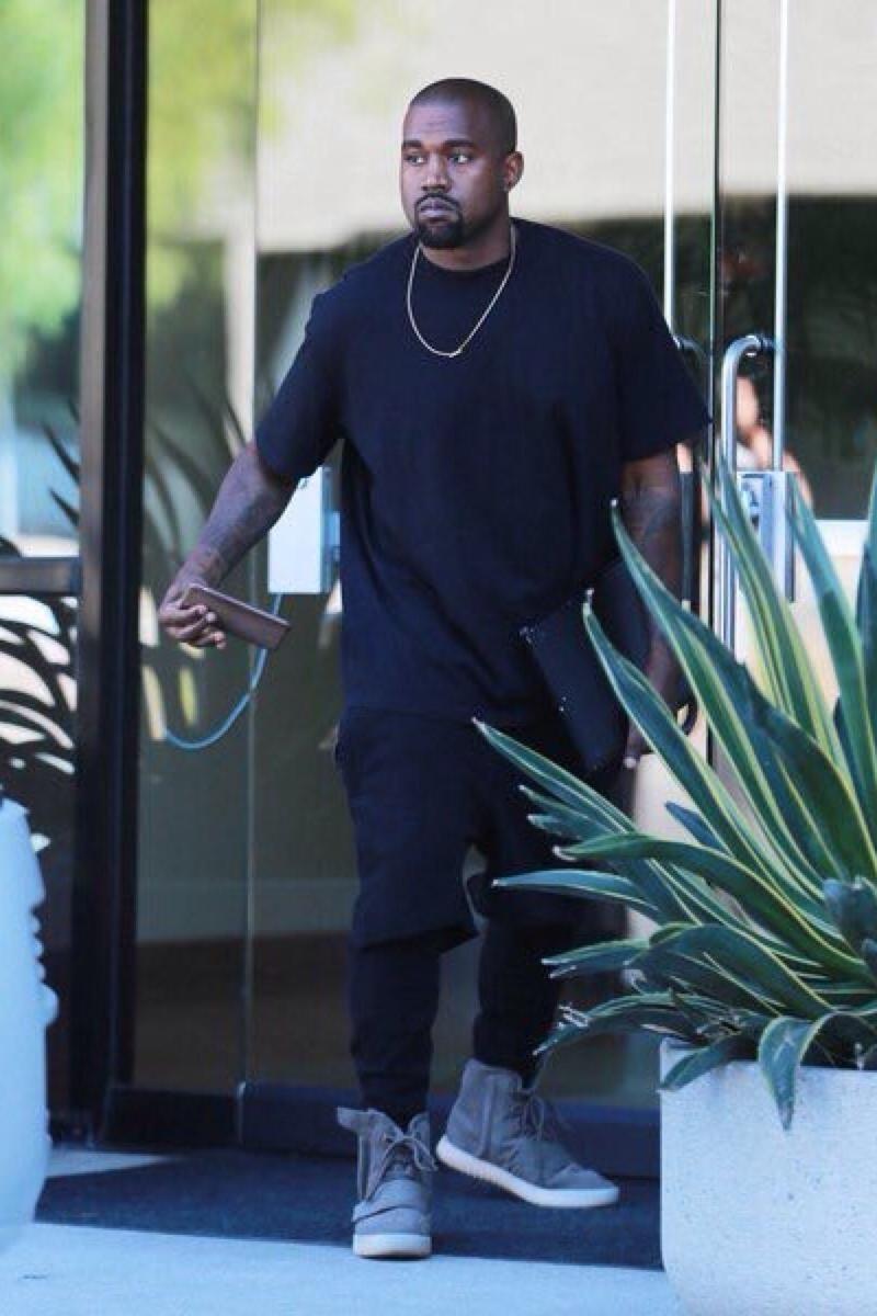 Kanye West wearing Yeezy Boost 750, Acne Chelsea Short T