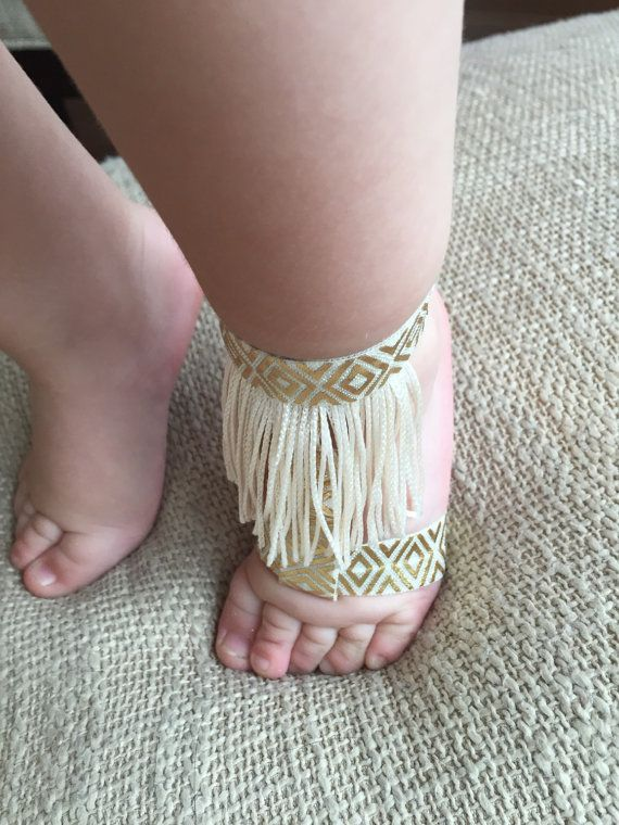 068082d8269 These gold and cream baby sandals are SO cute! Gold and cream elastic fit  over the ankle and foot