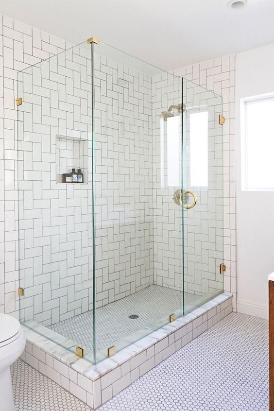 White Subway Tiles In The Shower Clad In Straight Herringbone Pattern White Subway Tile Shower Subway Tile Showers Bathroom Design Small