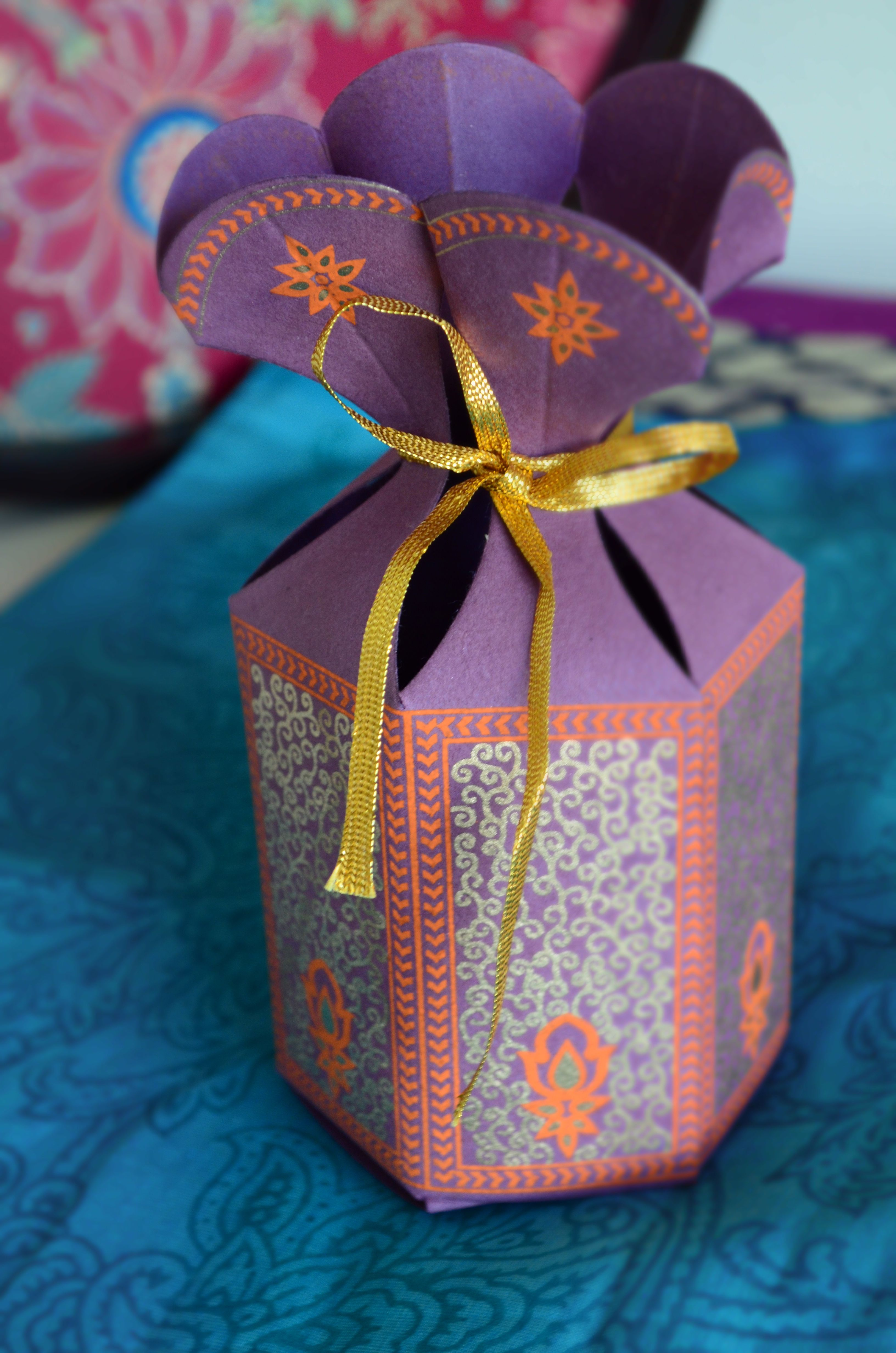 Standing hexagon pouch design with gold ribbon when easily