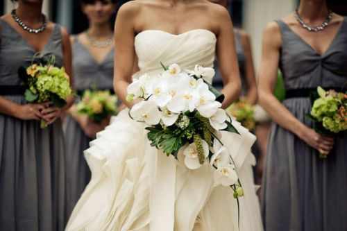 Grey bridesmaid dresses with green bouquets
