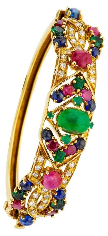 Multi-Stone, Diamond, Gold Bracelet----The hinged bangle is highlighted by an oval-shaped emerald cabochon weighing 2.00 carats, sapphire cabochons weighing a total of 2.50 carats, enhanced by ruby cabochons weighing a total of approximately 2.75 carats, accented by round and square-shaped emeralds weighing a total of approximately 1.10 carats, adorned by single-cut diamonds weighing a total of approximately 1.25 carats, having chrysoprase cabochons, set in 18k gold. Gross weight 32.10…
