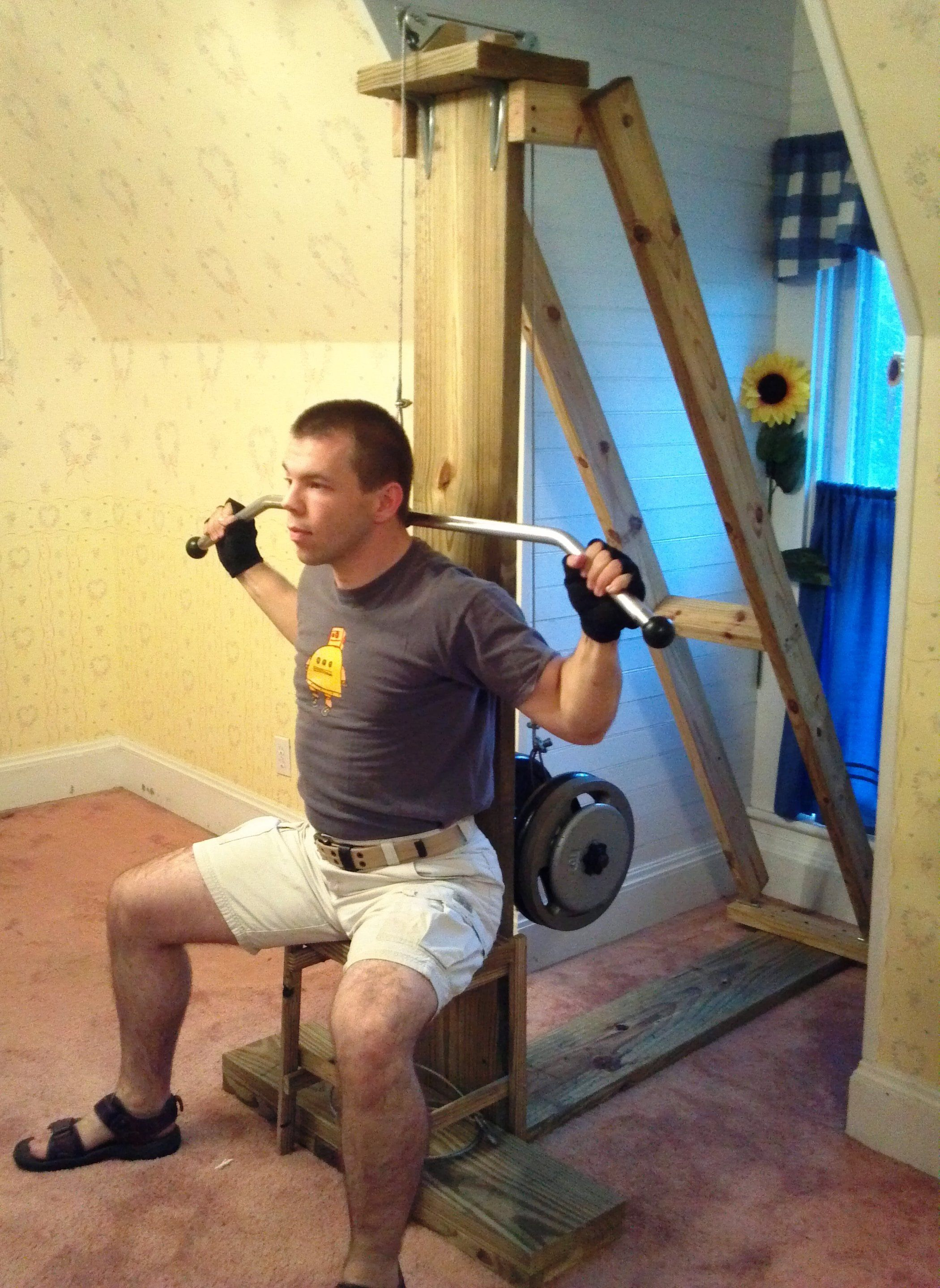 Cable exercise machine at home gym weight training