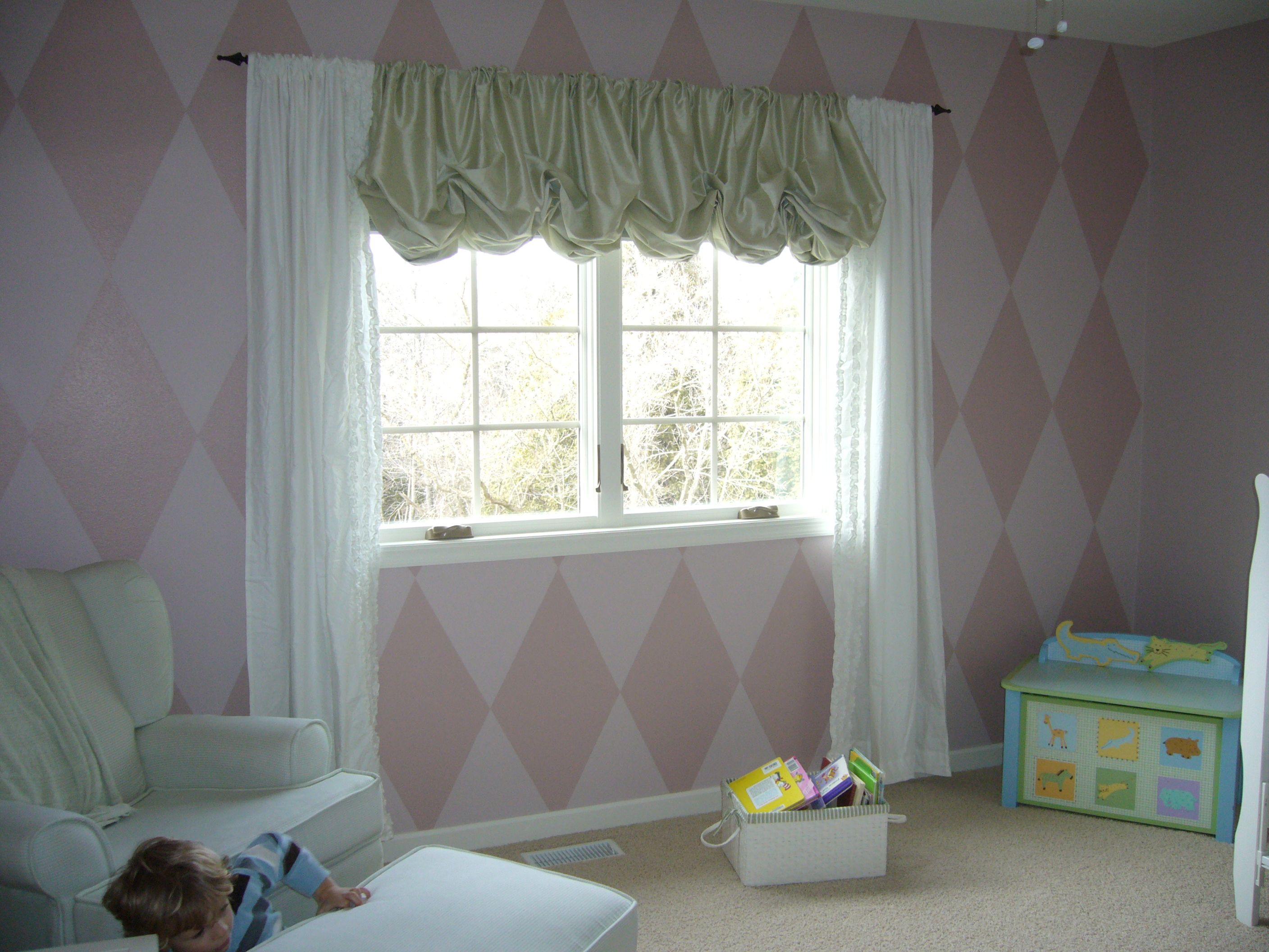 The diamonds add a playful touch in this nursery.