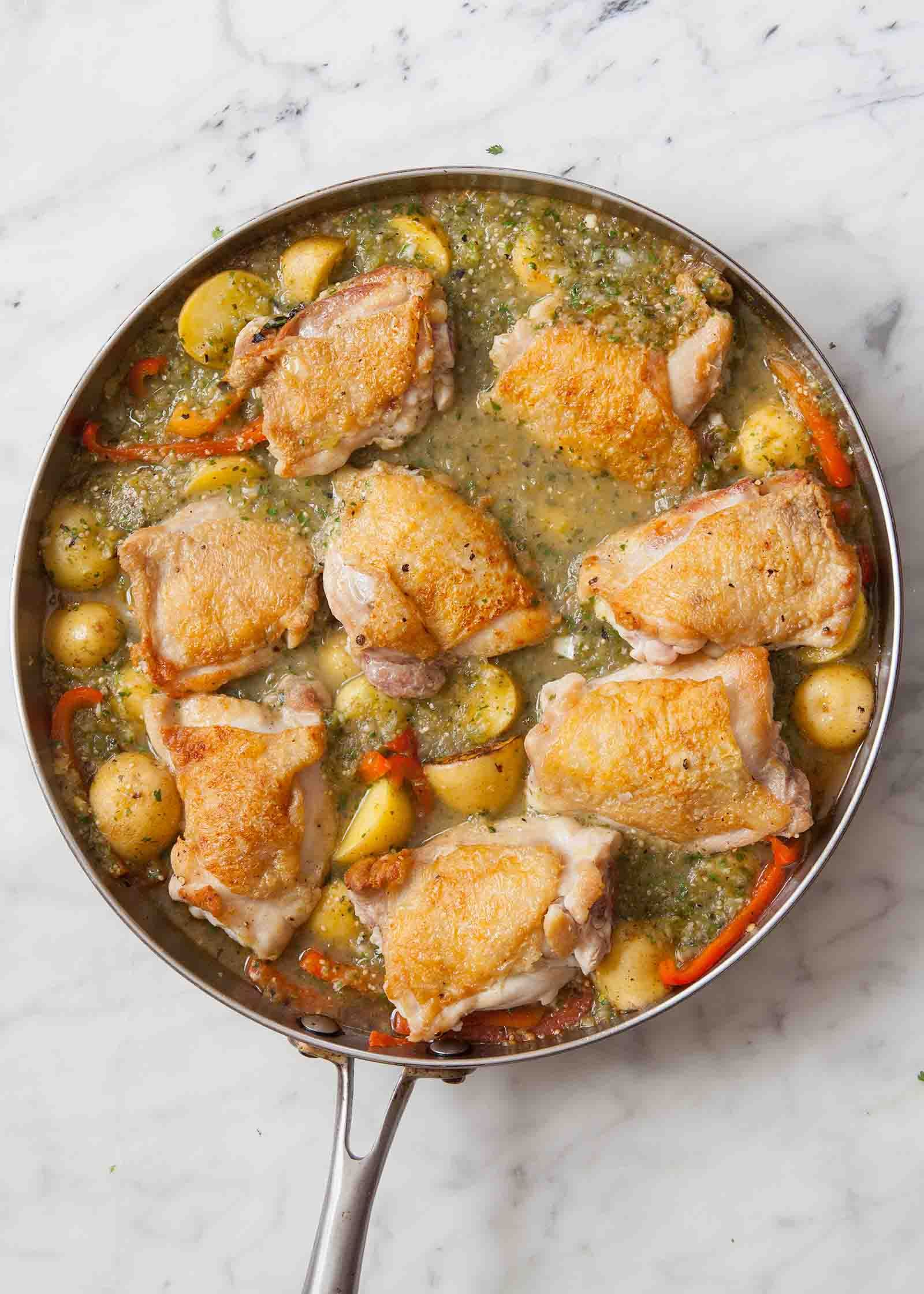 Easy stovetop chicken stew with tomatillo sauce, potatoes, corn, and peppers. Perfect for a late-summer dinner! #glutenfree