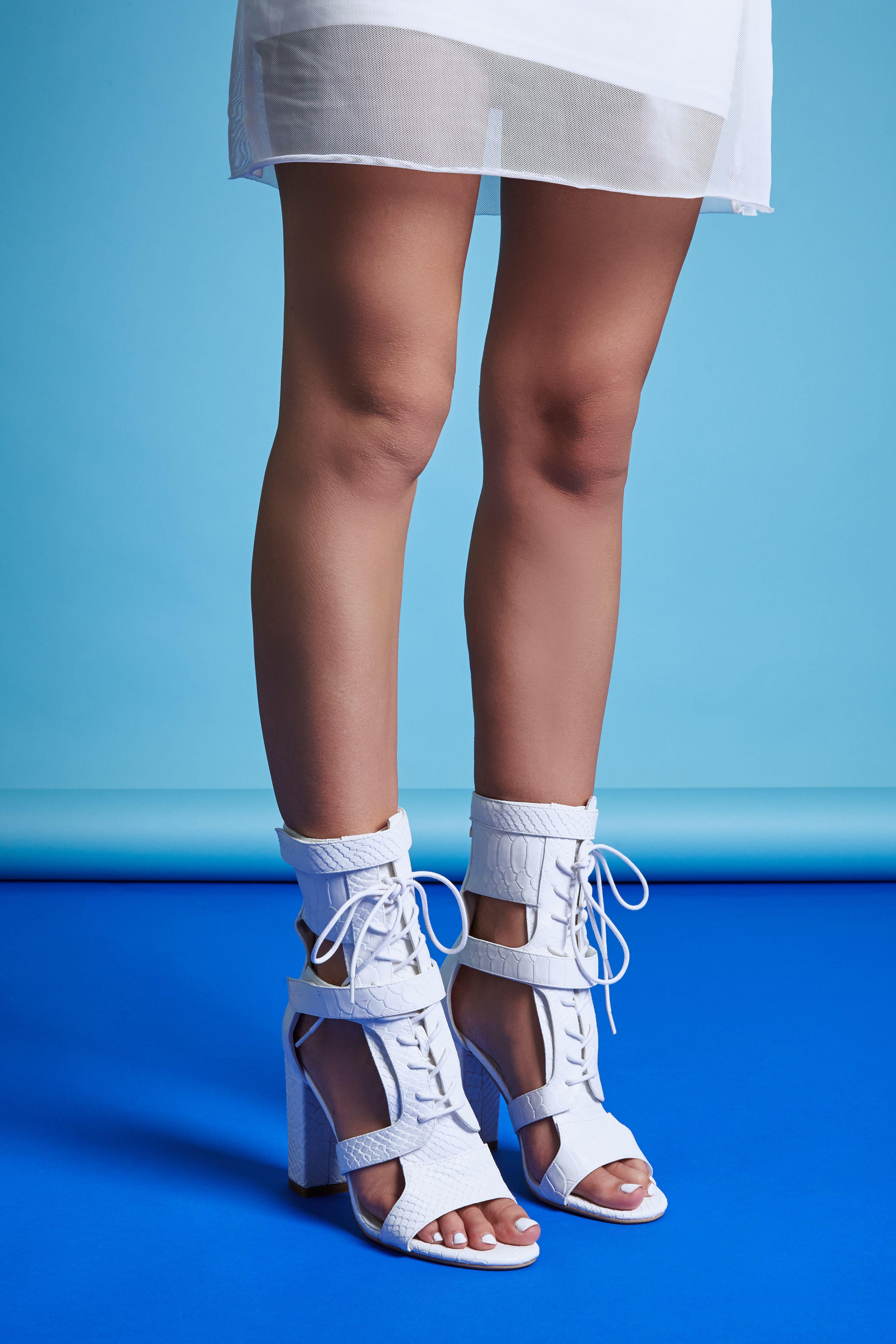 c555a566481 Khloe white snake print cut out lace up boots. Studio shoe photography!  Shop online