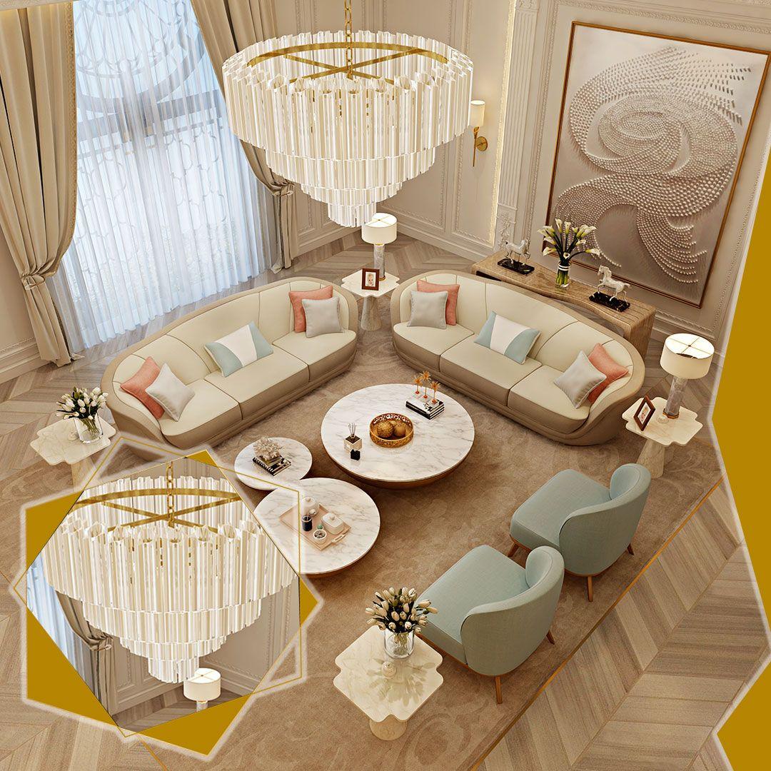 تضفي هذه الثريا الفخمة مظهرا دراماتيكيا كنقطة محورية لهذه الغرفة وتساهم الألوان الهادئة التي تجمع بين الوردي الفاتح والرما Home Decor Table Decorations Decor