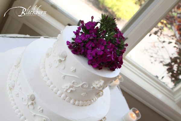 Blackburn Portrait Design Wedding and Portrait Photography www.susanblackburn.biz Buttercream frosting and purple floral topper Wedding Cake