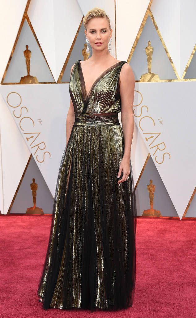 2017 Oscars  Charlize Theron wore a metallic Dior gown with pleating. I  love the metallic! The intricate pleating is marvelous! I love the earrings. 0a3e5f59025