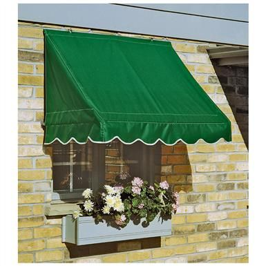 Shown Here Is A Sleek Nuimage Awnings Pro Series 7700 Retractable Awning With A Straight Valance And Sunbrella Striped F Retractable Awning Retractable Awning
