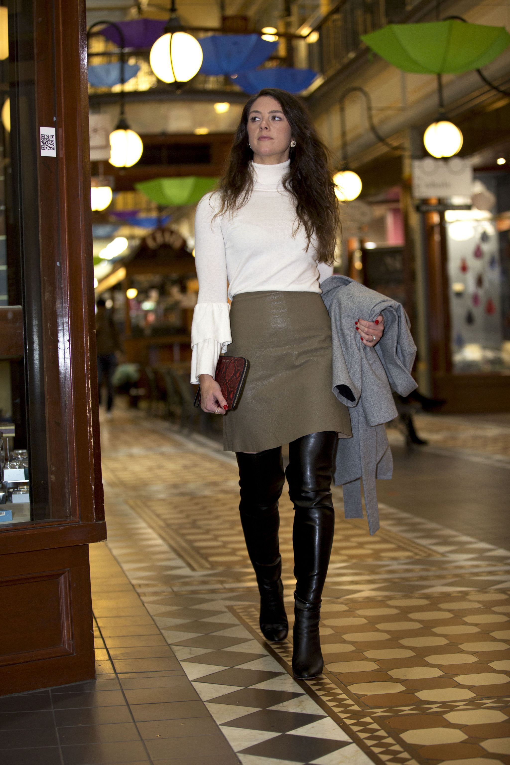 Olive drab leather skirt with black thigh boots street style