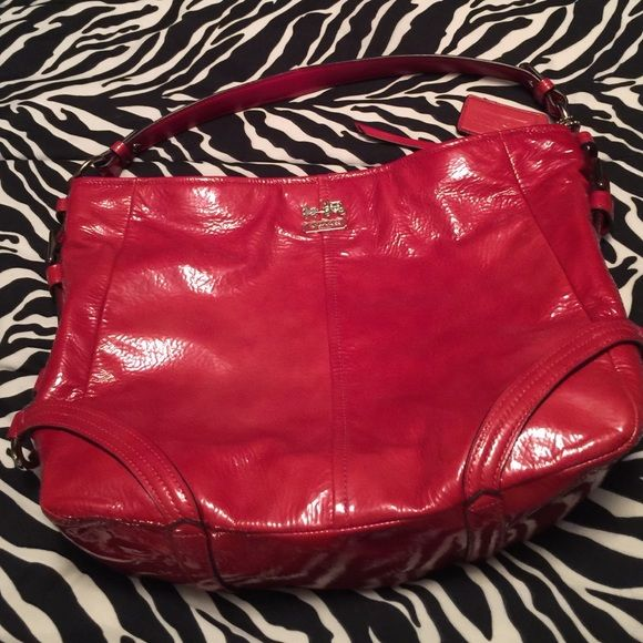 Coach handbag Coach handbag, Chelsea Katarina red patent, hobo style, zip close, interior zip & two slip pockets, salmon satin lining, one black mark on the patent (shown), otherwise good condition, clean interior, silver hardware, depth 3.5, strap drop 7.5, length 12, height 11.  Great price!❤️ Coach Bags Hobos