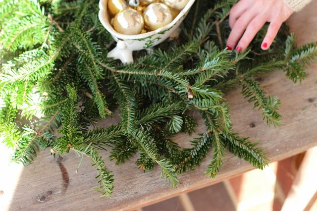using leftover Christmas tree branches to decorate front