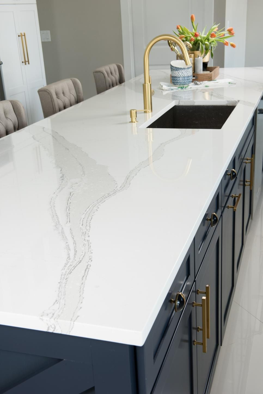 White Cambria Quartz Countertop On Wide Blue Kitchen Island