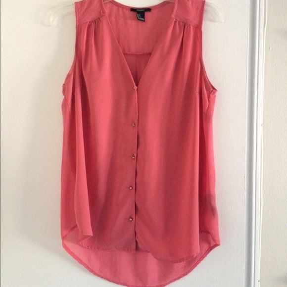 Coral dressy sleeveless top Coral top with gold accent buttons down the front. Back is sheer as pictured. Material breakdown is pictured in photo 4. Forever 21 Tops Blouses