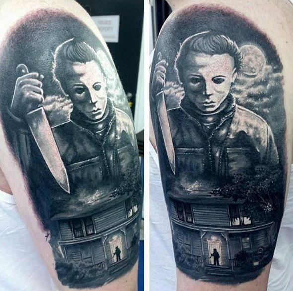 Halloween Inspired Black And Grey Tattoo With Michael Myers Featuring A Tiny Young Michael In Shadow Movie Tattoos Horror Movie Tattoos Michael Myers Tattoo