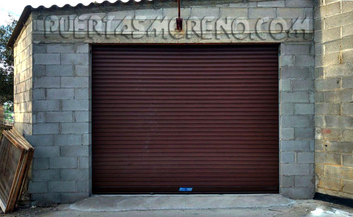 Ante A Persiana puerta metálica enrollable compuesta por lamas articuladas