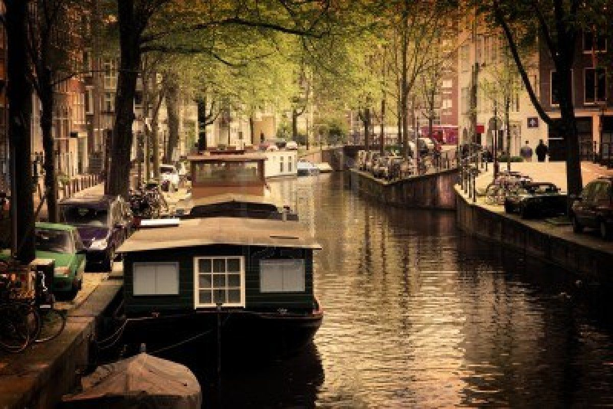 Amsterdam, Holland, Netherlands. Romantic canal, boats. Old town