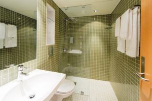 Upscale Bathrooms With Underfloor Heating. Bright And Modern With  Spotlights In The Ceiling, Bathroom