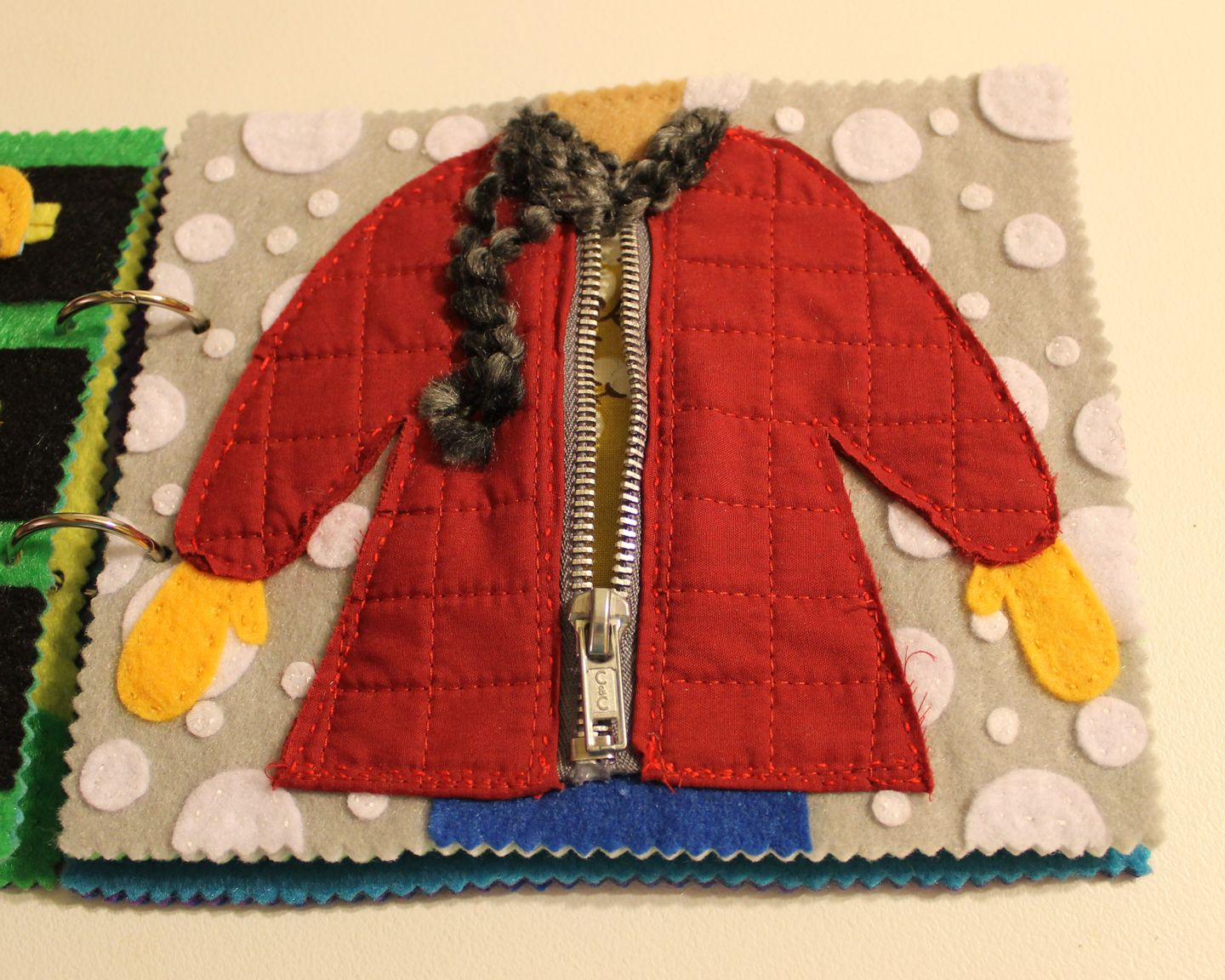 Here's a little something I've been working on lately. Another Quiet Book for a little girl named Juniper, but this time I attempted some moving parts. (These pictures aren't very good, but they co...
