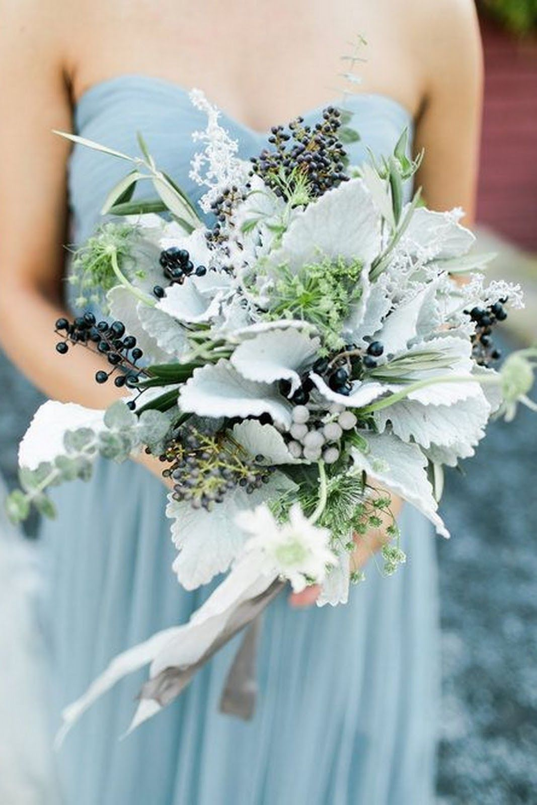 Dusty miller adds a delicate wintery touch to these gorgeous