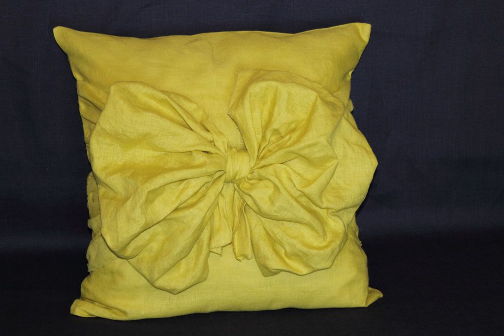 Pillow mustard color with a bow