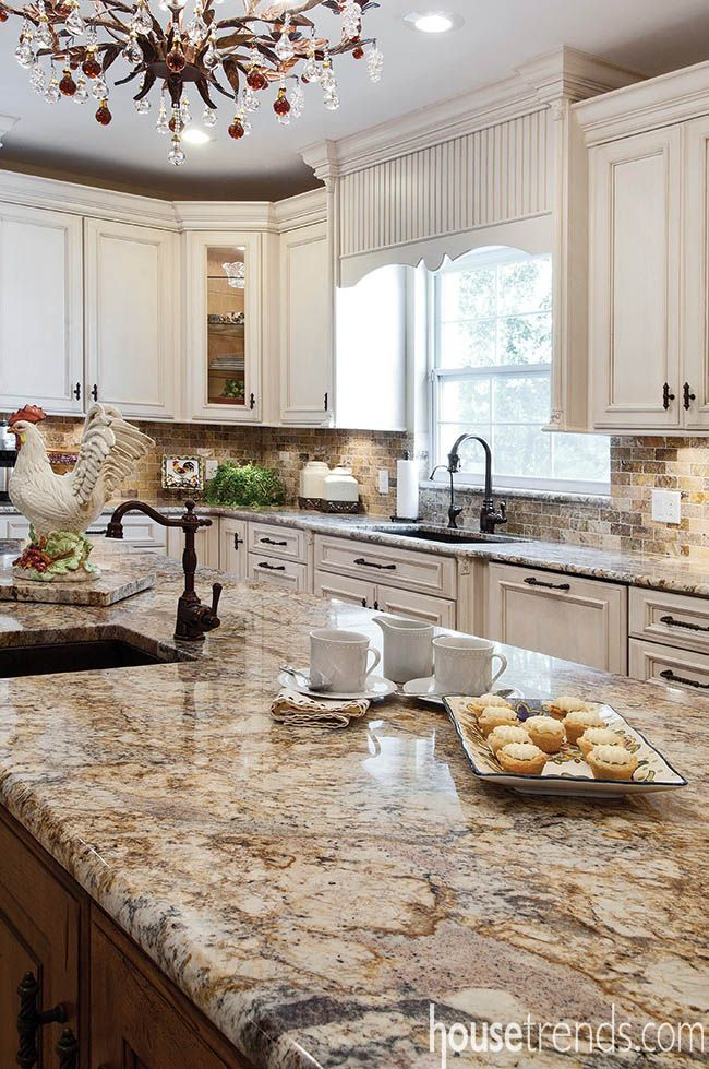 An espresso glaze adds character to the white perimeter cabinets and