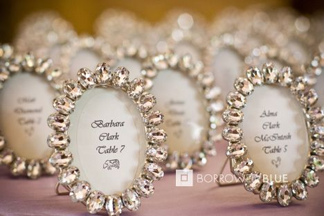 Wedding Favors AND escort cards. Cute idea, but I'd probably pick more gender neutral frames